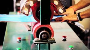 Heat transfer machine is an essential part of printing skateboard graphics on the board.