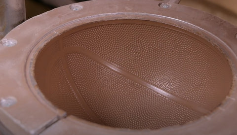 A mold that transfers the leather pattern on the basketball.