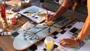 Coating your skateboard with a base for the printed graphics is though to be best practice.