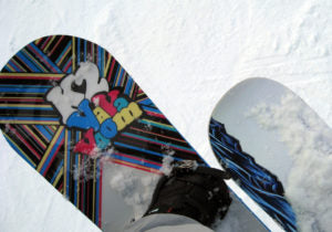 The snowboard topsheet with a printed graphic on it.