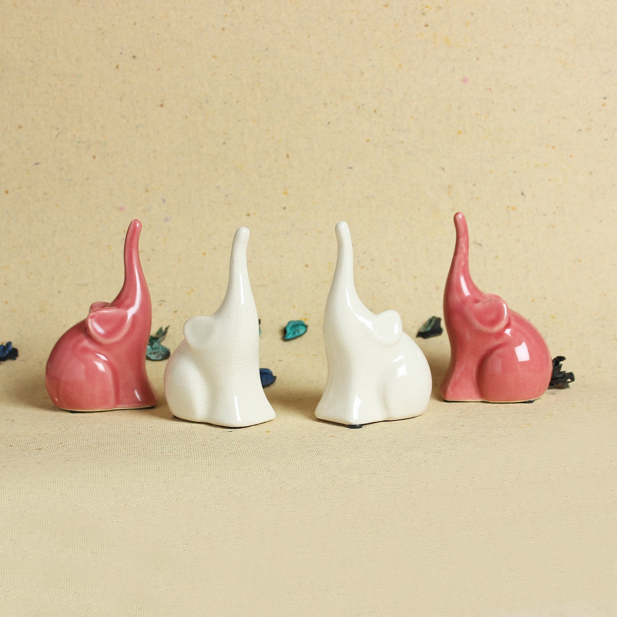 2 Small Elephants With Raised Tusk - Pink
