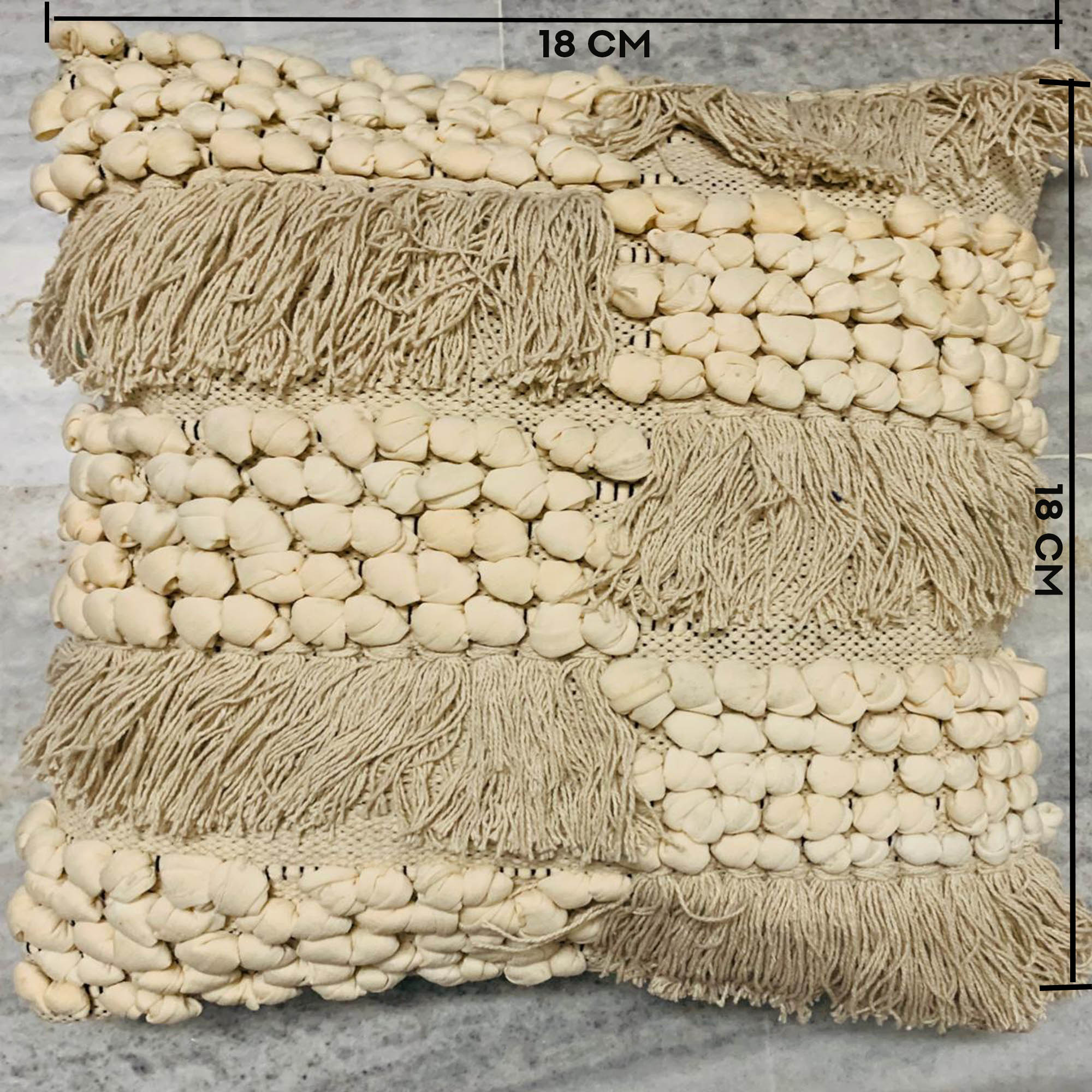 Beige color Pebbles & Tassel work cushion covers