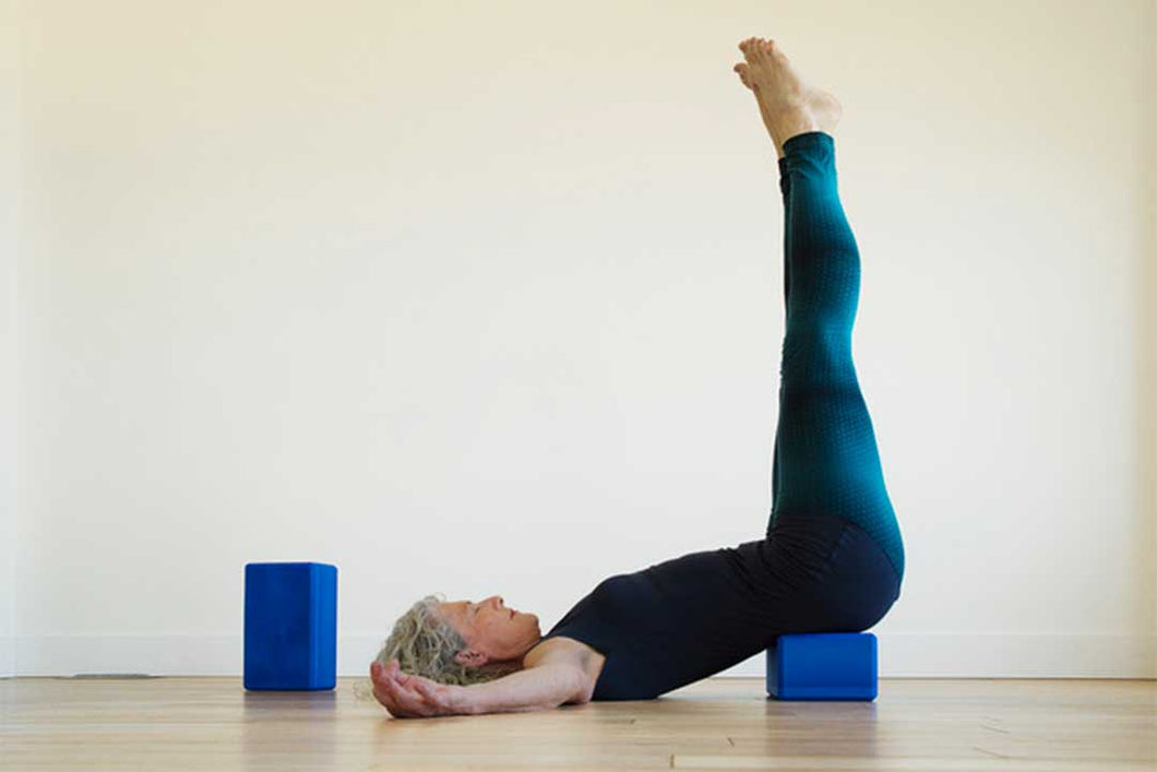 Heather using Yoga Big Blocks for legs up the wall pose