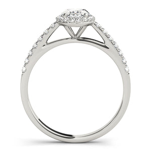 This beautiful white gold oval shaped halo engagement ring features a single row of micro pave set round brilliant cut diamonds framing the oval diamond of your choice.