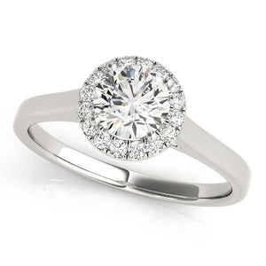 This classic halo engagement ring features a micro pave set diamonds around the center gem.