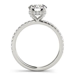 This gorgeous engagement ring features a sparkling hidden halo of diamonds that wraps around the center diamond.