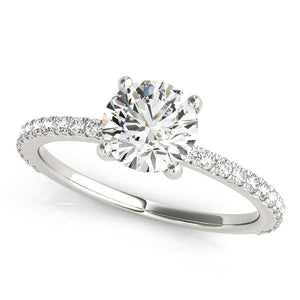 This beautiful pave diamond engagement ring is created to maximize the light that hits the diamonds from all around.