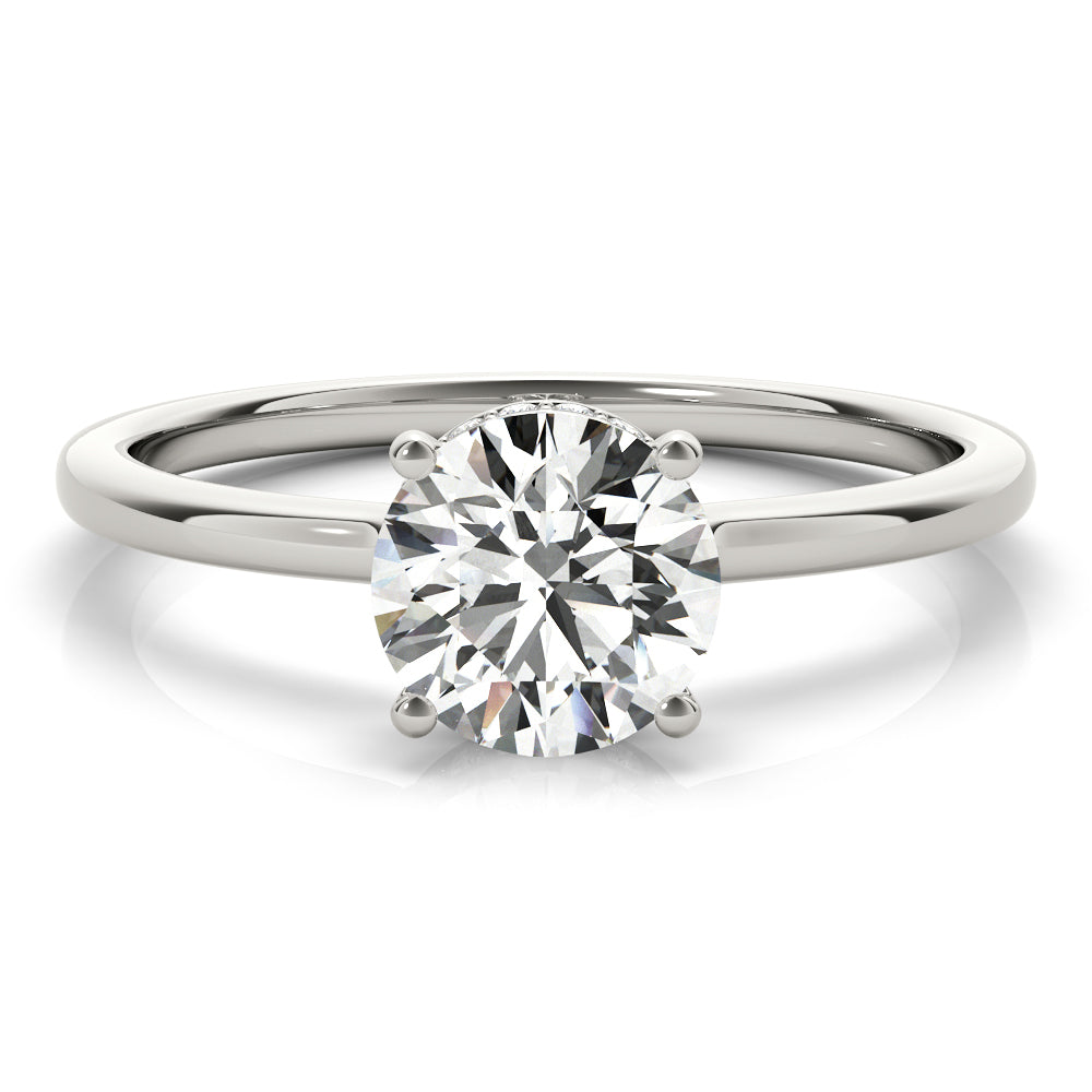 This elegant engagement ring features a sparkling hidden halo of diamonds that wraps around the center diamond.