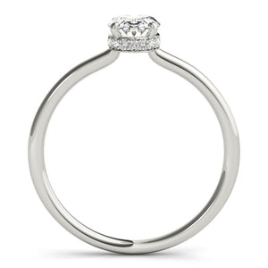 This elegant oval engagement ring features a sparkling hidden halo of diamonds that wraps around the center diamond.