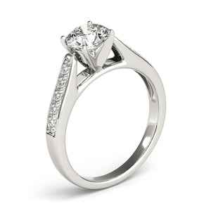This beautiful diamond engagement ring showcases ten round diamonds that are set in white gold channel design to accent your center diamond.