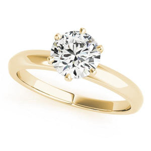 This six-claw solitaire is the ultimate classic engagement ring style