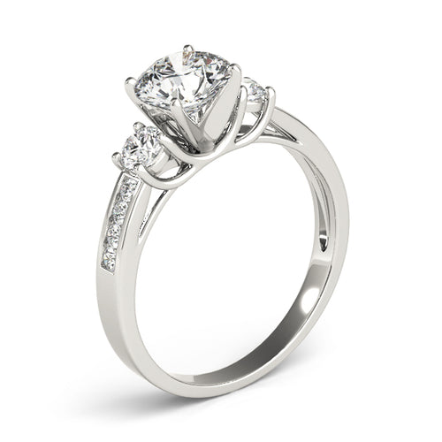 This beautiful three stone diamond engagement ring showcases eight round diamonds that are set in channel design to accent your center diamond.