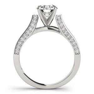 This unique design engagement ring features pave set diamonds that are set on the side of the shank to compliment the center diamond of your choice.