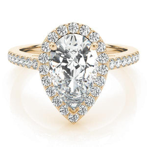 This elegant white gold pear shape halo engagement ring featuring pave set diamonds and your choice of center stone.