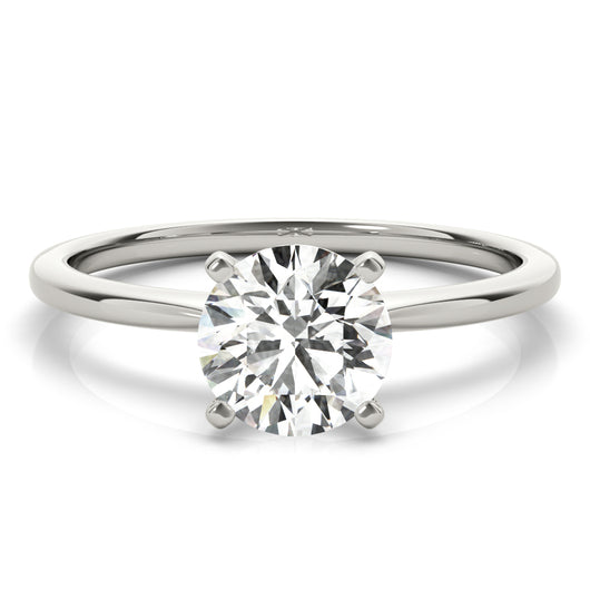 Simply elegant. This knife edge solitaire engagement ring is perfect to showcase the center diamond of your choice.