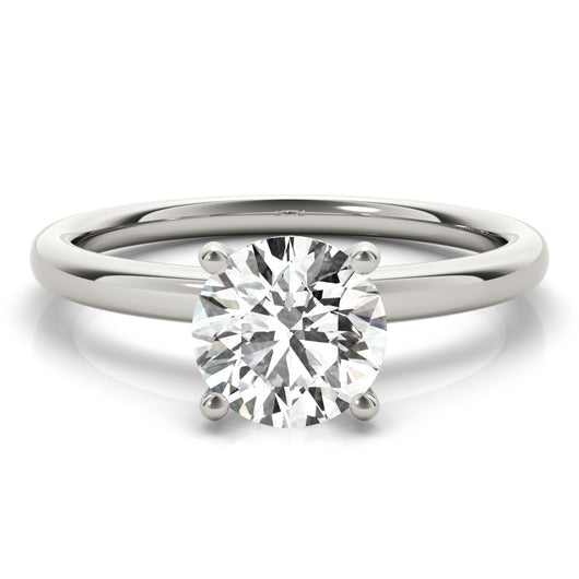 This classic solitaire engagement ring features modern decorative diamond crown.