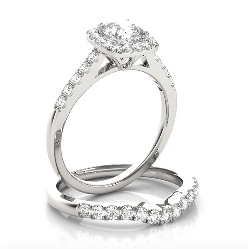 This modern square halo engagement ring features a single row of micro pave set round brilliant cut diamonds and your choice of center stone.