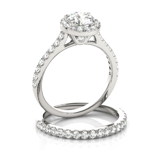 This classic halo engagement ring features a micro pave set diamonds with a center stone of your choice.