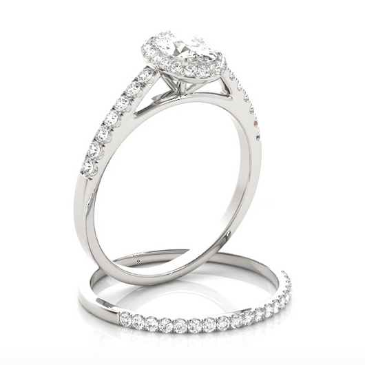 This beautiful oval shaped halo engagement ring features a single row of micro pave set round brilliant cut diamonds framing the oval diamond of your choice.