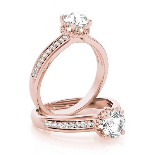This intricate design engagement ring features a pave set diamonds with a center diamond of your choice.