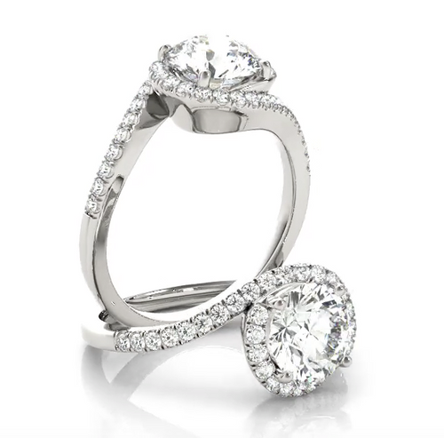 This modern engagement ring bypass features pave set diamonds with the center stone of your choice.