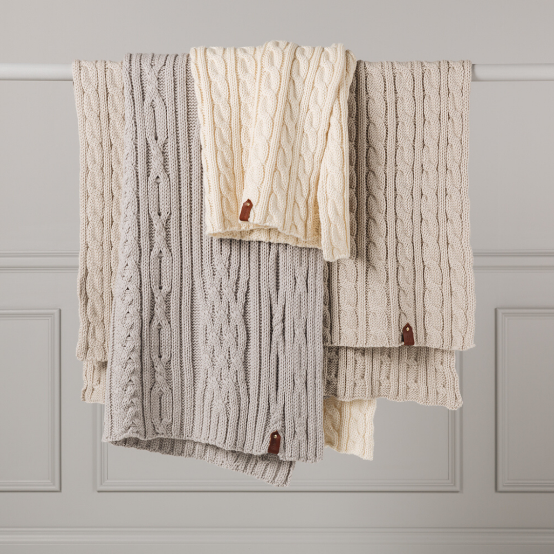 From left Limited Edition Cable Rib Throw (Oatmeal), Limited Edition Cable Sampler Throw (Soft Grey), Limited Edition Cable Rib Throw (Natural)
