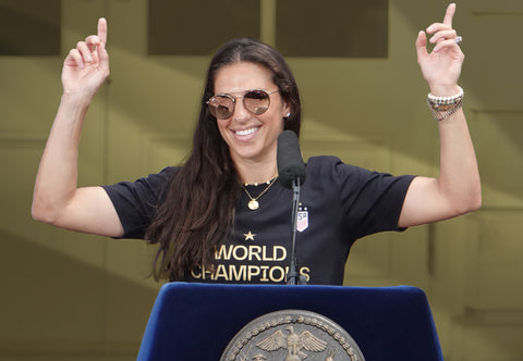 Carli Lloyd with sun glasses at an interview
