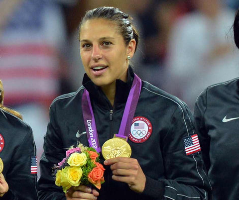 Carli Lloyd with the gold olympic medal