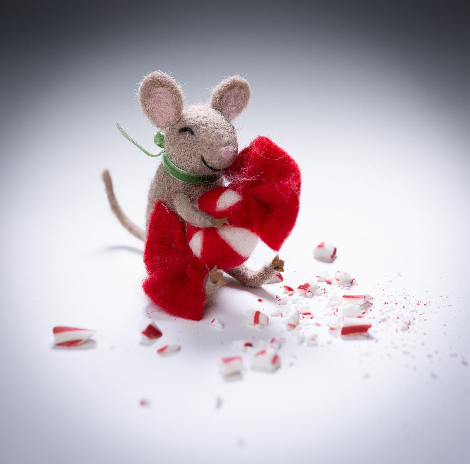 Felt Mouse carrying a Peppermint