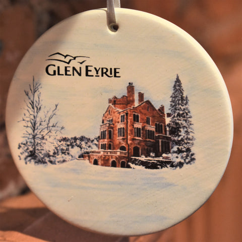 Ceramic ornament with a side view of a castle in the snow.