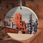 Ceramic ornament with a castle in the snow with stairs.