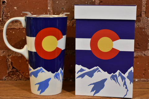 A mug featuring the Colorado emblem with snowy mountains and a matching square gift box.