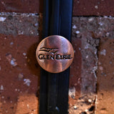 Metal Glen Eyrie magnet with logo in copper.