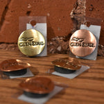 Metal Glen Eyrie magnets in brass and copper.