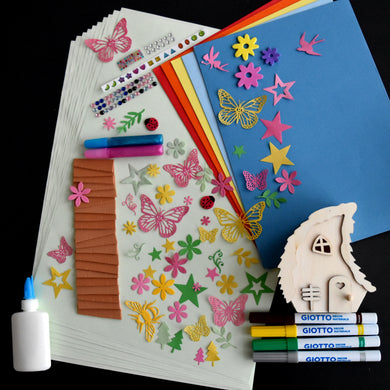 Small wooden fairy house craft kit, including roof tiles, paper, PVA glue, stick on gems, paper butterflies, stars and trees, Giotto pens and both A3 & A4 coloured paper