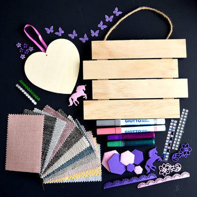 Craft kit including wooden hanger with four slats, wooden heart, assorted fabric, pens, glue, gems and paper butterflies.