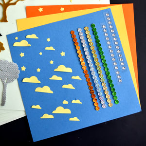 Selection of square paper, yellow paper clouds, holographic sticky back dots and clear gems