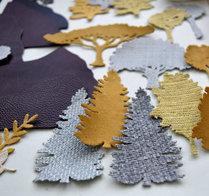 Selection of tree silhouette cut from textured fabrics