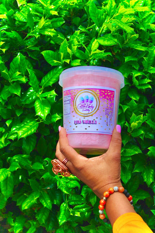 16-oz sealable container with gourmet cotton candy and green grass wall as background