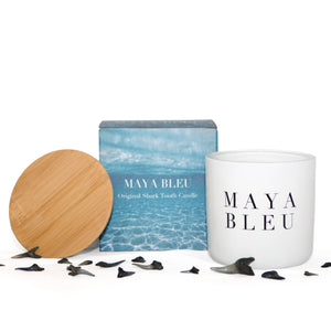 Not just another candle, the Maya Bleu Shark Tooth Candle brings the beach into your home with fossilized shark teeth embedded in the vanilla scented wax.