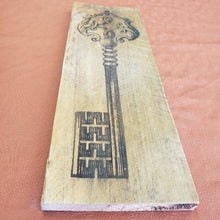 Load image into Gallery viewer, Skeleton key wood burning on rustic farm wood