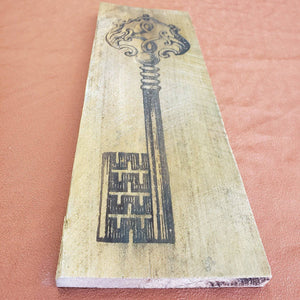 Skeleton key wood burning on rustic farm wood