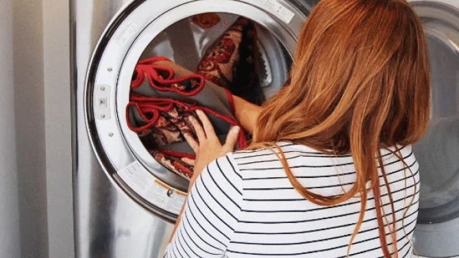 Woman putting a run in a washing machine