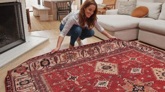 Woman laying a rug on the floor