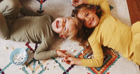 Kids playing on a ruggable rug