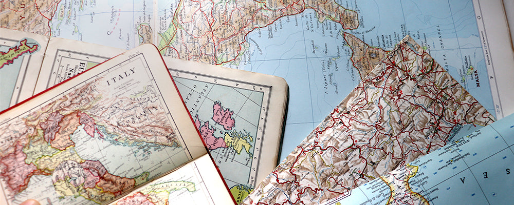 Vintage maps used for creating personalised map jewellery and bespoke cufflinks