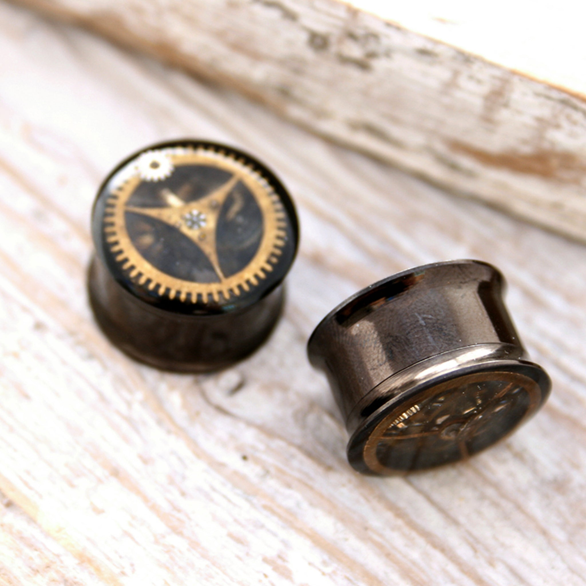 14mm double flare black ear gauges in steampunk style