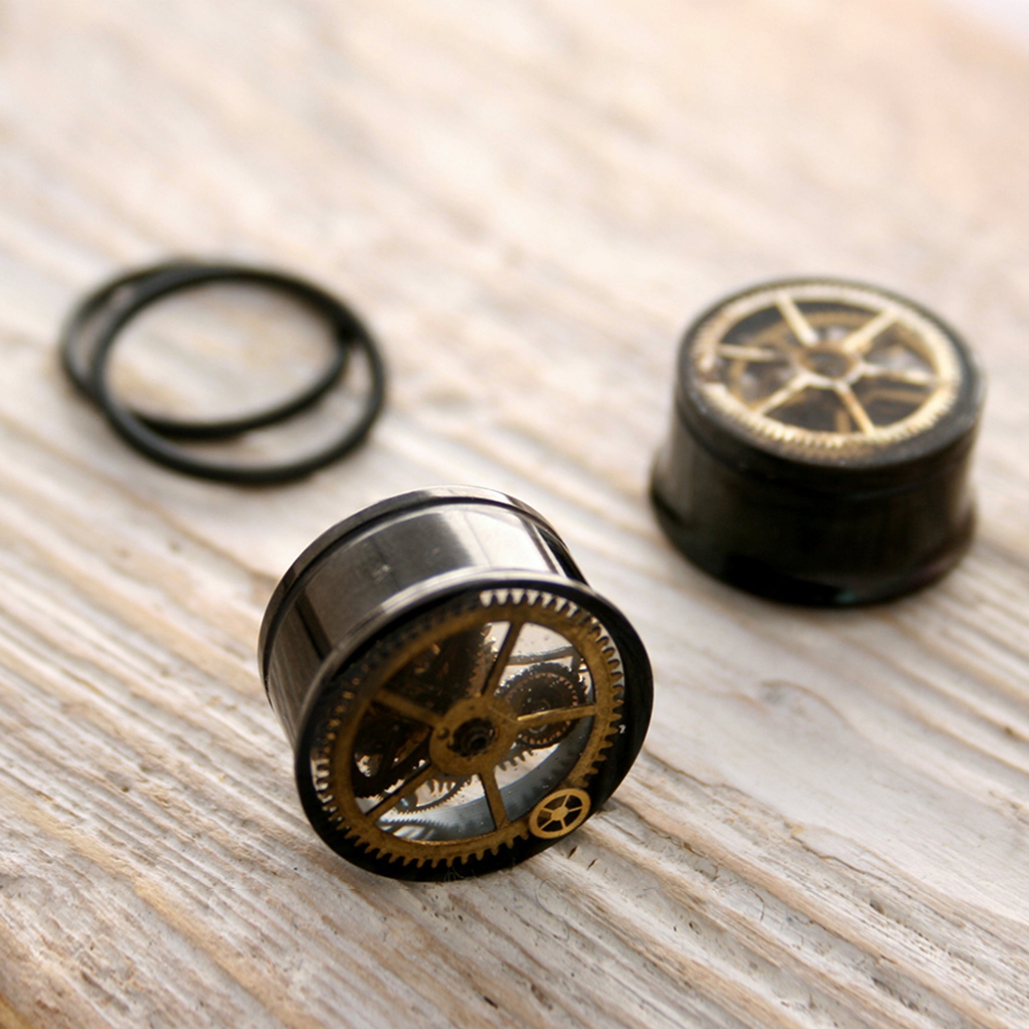 Black steampunk plug earrings with real watch parts in resin with o-rings