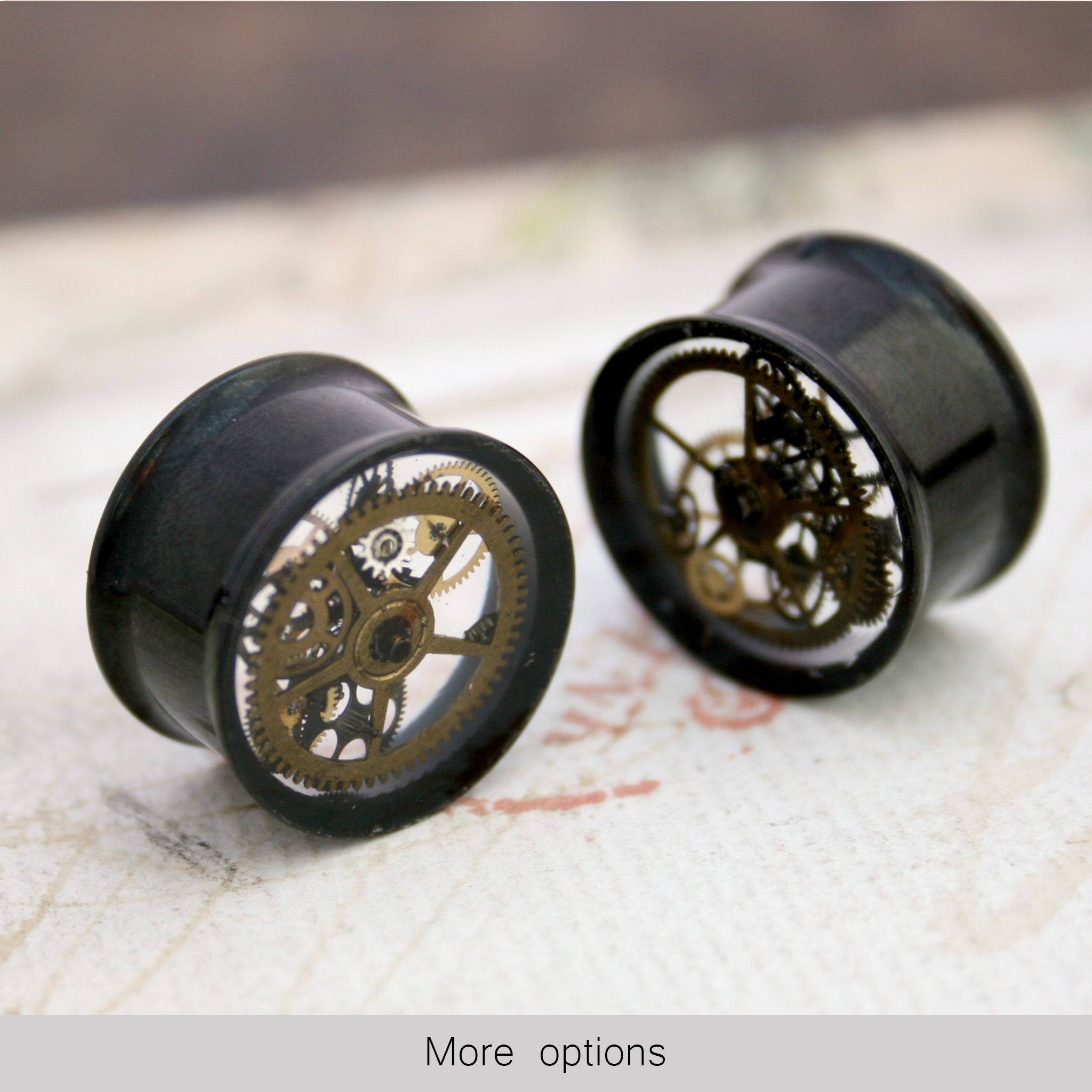Black steampunk plug earrings with real watch parts in resin