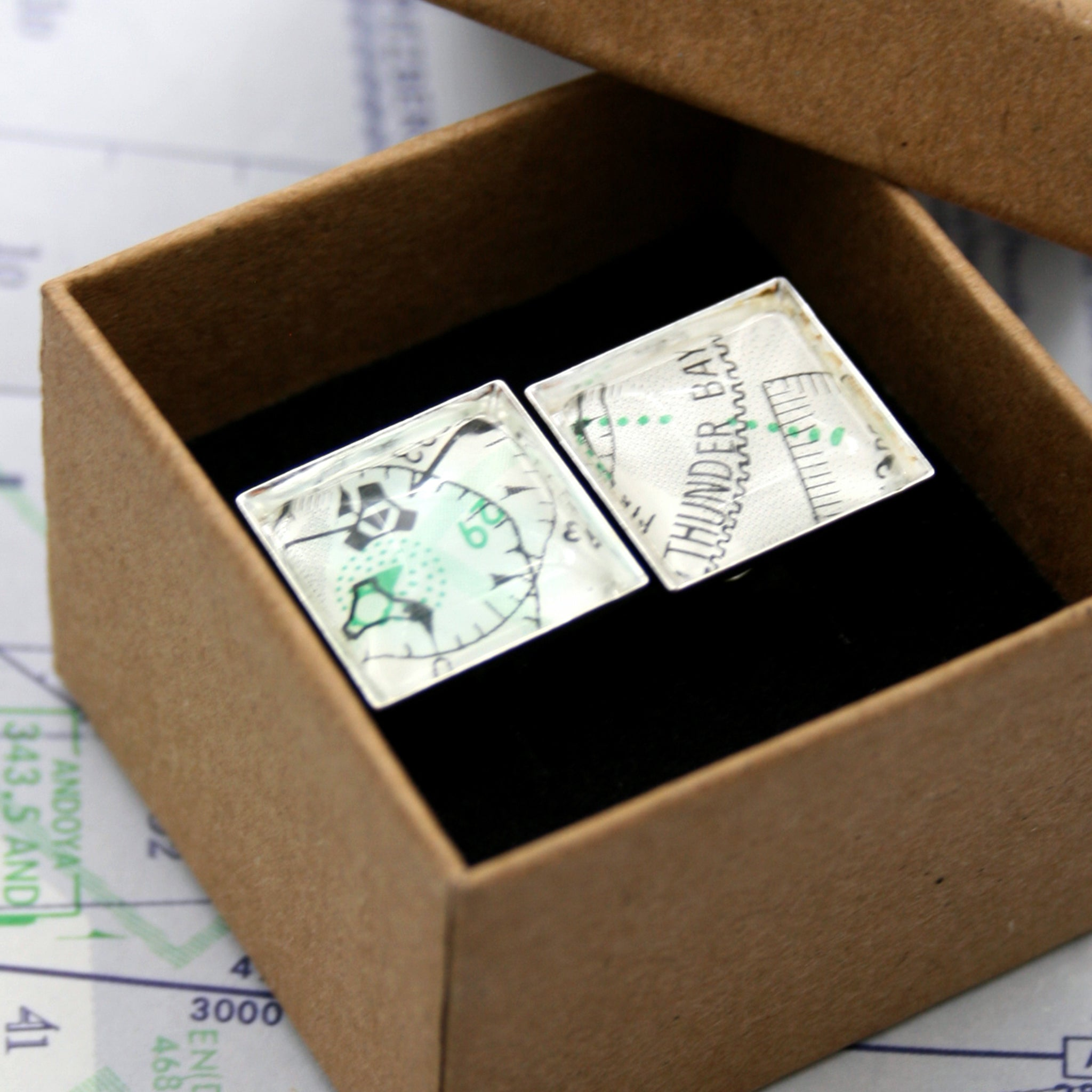 Pilot cufflinks made of aeronautical charts in a box